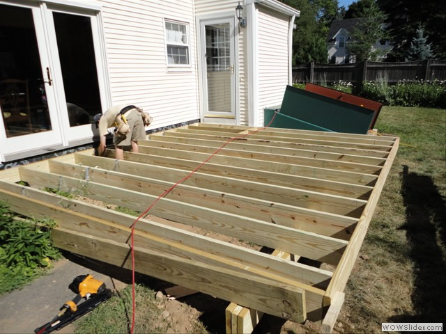A good foundation is key to a long lasting, stury deck.  Here's the beginning of a good, strong deck in Wenham by Tom McDermott