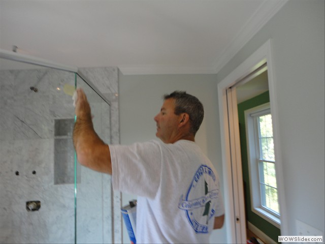 Tom McDermott of TPM Construction - finishing a Bathroom Remodel job.  Call now for a free estimate (603) 396-5974